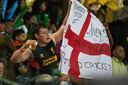 © Licensed to London News Pictures. 27/09/2012. An English cricket fan holds a an England flag  during the T20 Cricket World super 8's match between England Vs West Indies at the Pallekele International Stadium Cricket Stadium, Pallekele. Photo credit : Asanka Brendon Ratnayake/LNP