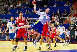 Igor Vori of Croatia and Miha Zvizej of Slovenia during handball match between Slovenia and Croatia in  2nd Round of Preliminary Round of 10th EHF European Handball Championship Serbia 2012, on January 18, 2012 in Millennium Center, Vrsac, Serbia. Croatia defeated Slovenia 31-29. (Photo By Vid Ponikvar / Sportida.com)
