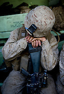 Marine Lance Corporal Johnson rests on his weapon in the back of an Assault Amphibious Vehicle (AAV) during live-fire exercises for the 2nd Battalion, 5th Marine Regiment at Camp Pendleton.