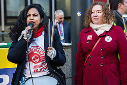 London, UK. 22nd January, 2019. Claudia Turbet-Delof of United Voices of the World (UVW) addresses support staff at the Department for Business, Energy and Industrial Strategy (BEIS) represented by the Public and Commercial Services (PCS) union on the picket line after beginning a strike for the London Living Wage of £10.55 per hour and parity of sick pay and annual leave allowance with civil servants. The strike is being coordinated with receptionists, security staff and cleaners at the Ministry of Justice (MoJ) represented by the UVW.