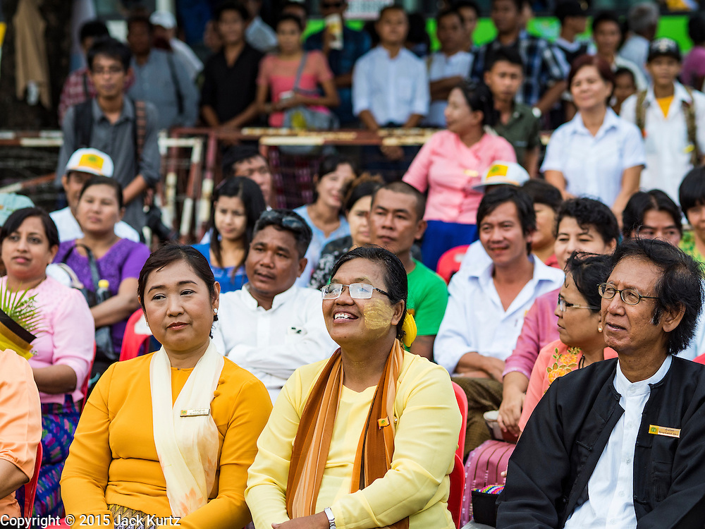 03 NOVEMBER 2015 - YANGON, MYANMAR: People in downtown Yangon listen to speakers at a Democratic Party Myanmar campaign rally. The Democratic Party of Myanmar was established in the wake of the 1988 protests and contested the 2010 elections. The party is running candidates in several races for the Myanmar legislature.        PHOTO BY JACK KURTZ