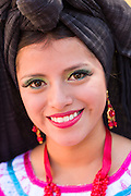 Traditional costumed Zapotec maiden smiles October 26, 2014 in Oaxaca, Mexico.