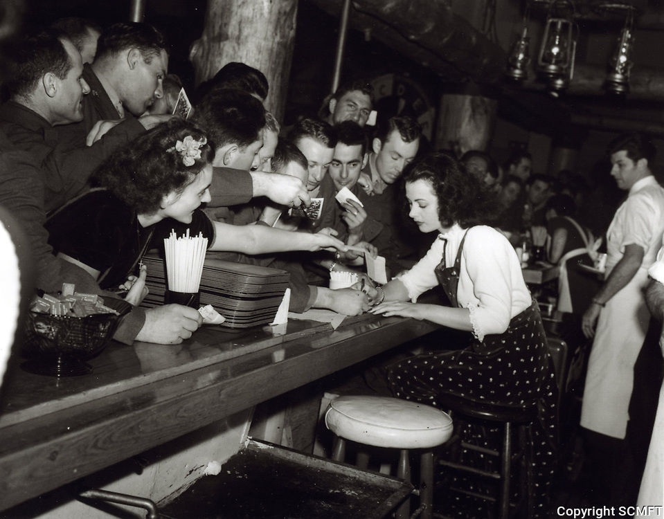 1943 Hedy Lamar signs autographs at the Hollywood Canteen