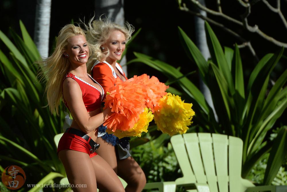 January 22, 2014; Ko'Olina, HI, USA; Tampa Bay Buccaneers cheerleader Ashlee (front) and Denver Broncos cheerleader Heather Hartman (back) perform during the Pro Bowl draft at J.W. Marriott Ihilani Resort & Spa.