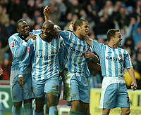 Photo: Ed Godden.<br />Coventry City v Derby County. Coca Cola Championship. 21/01/2006. <br />L-R, Coventry's Stern John, Dele Adebola (goal scorer), Marcus Hall and Dennis Wise celebrate.