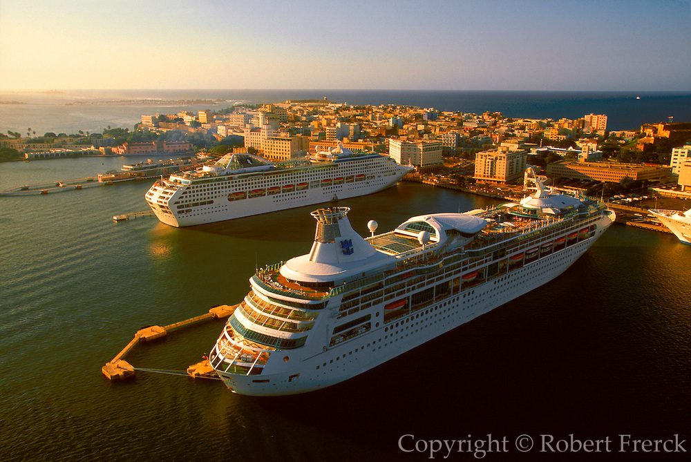 PUERTO RICO, SAN JUAN skyline of the city with harbour and huge luxury ocean liners tied up at tourism terminal