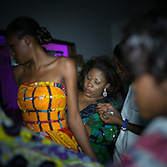 Lydie Malingumu preparing a model in Kinshasa Fashion week backstage. CAPTA/FEDERICO SCOPPA