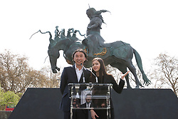 © licensed to London News Pictures. London, UK. 14/04/2012. Sculptor Dashi Namakov (left) and his translator (right) speaking at the unveiling of a statue of Genghis Khan at Marble Arch in central London on April 14, 2012. Photo credit: Tolga Akmen/LNP