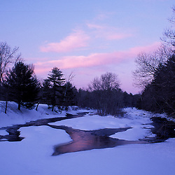 The Lamprey River in winter from the bridge on Lee-Hook Road. Sunset. A federally designated Wild and Scenic River.  Lee, NH