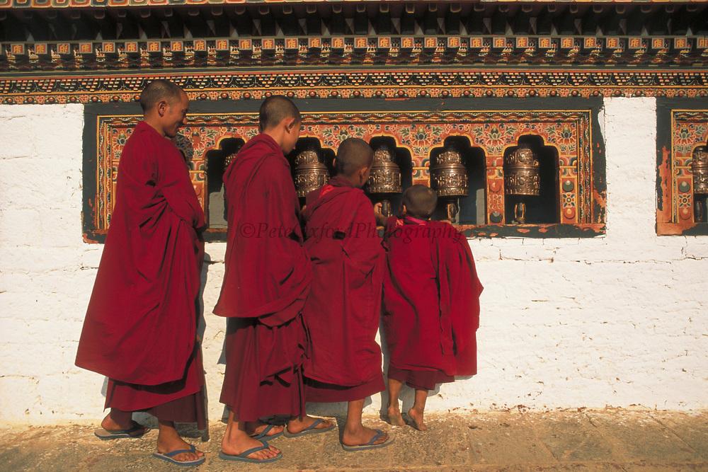 Monks Turning Prayer Wheels<br />Dzongchung Temple<br />Punakha Dzong<br />BHUTAN