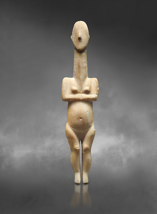 Cycladic statue figurine of the naturalistic 'Plastira' type of Paros from Glypha cemetery, grave 23, Cat no 4762. Early Cycladic Period I (Grotta-Pelos Phase 3200-2800 BC). National Archaeological Museum, Athens.   Gray background.<br /> <br /> <br /> This type of Cycladic figurine stand with feet lat to the ground with detailed facial features and ears to make a more realistic statue. .<br /> <br /> If you prefer to buy from our ALAMY PHOTO LIBRARY  Collection visit : https://www.alamy.com/portfolio/paul-williams-funkystock/cycladic-art-artefacts.html Type into the LOWER SEARCH WITHIN GALLERY box to refine search by adding background colour, place, museum etc<br /> <br /> Visit our CYCLADIC CIVILISATIONS PHOTO COLLECTIONS for more photos to download or buy as wall art prints https://funkystock.photoshelter.com/gallery-collection/Cycladic-civilisation-Ancient-Greek-Artefacts-art-Photos-Pictures-Images/C0000CmevVvnC.XU