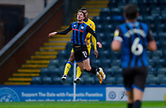 Rochdale forward Jake Beesley (11) wins the header during the EFL Sky Bet League 1 match between Rochdale and AFC Wimbledon at the Crown Oil Arena, Rochdale, England on 21 November 2020.