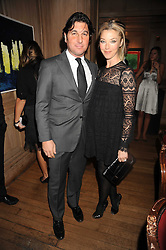 TAMARA BECKWITH and her husband GEORGE VERONI at a party to celebrate the launch of Hollywood Domino - a brand new board game, held at Mosimann's 11b West Halkin Street, London on 7th November 2008.  The evening was in aid of Charlize Theron's Africa Outreach Project.