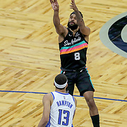 ORLANDO, FL - APRIL 12: Patty Mills #8 of the San Antonio Spurs attempts a shot over R.J. Hampton #13 of the Orlando Magic during the first half at Amway Center on April 12, 2021 in Orlando, Florida. NOTE TO USER: User expressly acknowledges and agrees that, by downloading and or using this photograph, User is consenting to the terms and conditions of the Getty Images License Agreement. (Photo by Alex Menendez/Getty Images)*** Local Caption *** Patty Mills; R.J. Hampton