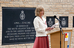 © Licensed to London News Pictures.20/05/2012, National Memorial Arboretum, Alrewas, Staffordhire, UK.The Service and Dedication of the Falklands Memorial at the National Memorial Arboretum took place earlier today. Pictured, Sara Jones, widow of Colonel H Jones during her reading. Photo credit : Dave Warren/LNP