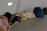 Homeless people sleep in Hamamatsu Station. Hamamatsu, Shizuoka, Japan. Sunday, March 22nd 2009