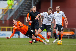 Dundee United's Peter Pawlett and Partick Thistle's Darren Brownlie. half time : Dundee United 1 v 0 Partick Thistle, Scottish Championship game played 7/3/2020 at Dundee United's stadium Tannadice Park.