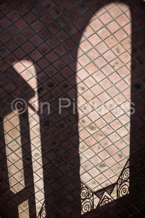 Shadows cast by intricate iron railings at Sir Victor Sassoons Hamilton House in Shanghai, China on September 21, 2014. Sassoon was a jewish tycoon that left a series of buildings that once dominated the city of Shanghai in the 1920s and 30s.
