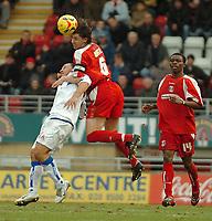 Photo: Ed Godden.<br />Leyton Orient v Carlisle United. Coca Cola League 2. 11/02/2006. <br />Leyton Orient captain, John Mackie (C) rises high above Carlisle's Karl Hawley.