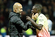 Manchester City manager Pep Guardiola congratulates Manchester City defender Benjamin Mendy after the EFL Cup match between Preston North End and Manchester City at Deepdale, Preston, England on 24 September 2019.