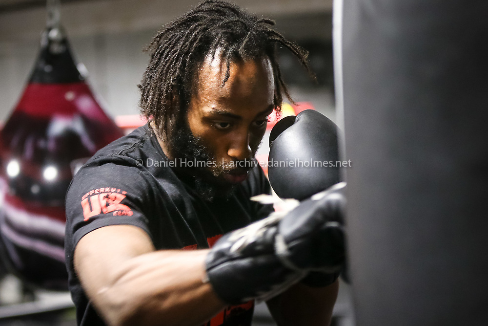 (7/19/16, ASHLAND, MA) Boxer Christopher Davis-Fogg does some sparring at UpperKuts Boxing Club in Ashland on Tuesday. Daily News and Wicked Local Photo/Dan Holmes