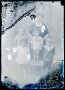 eroding glass plate photo of mother with little children