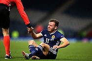 Scotland forward Ryan Fraser (11) (Bournmouth) gets a helping hand from Referee Tobias Welz during the UEFA Nations League match between Scotland and Israel at Hampden Park, Glasgow, United Kingdom on 20 November 2018.