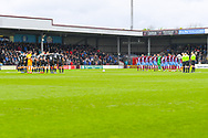 Both teams observe a minute silence during the EFL Sky Bet League 1 match between Scunthorpe United and Bradford City at Glanford Park, Scunthorpe, England on 27 April 2019.