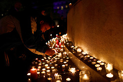November 13, 2016 - Paris, France - A picture taken near the Bataclan concert hall in Paris on November 13, 2016 shows flowers, messages and candles displayed at a makeshift memorial as France marked the first anniversary of the Paris attacks with sombre ceremonies and painful memories for the relatives of the 130 people killed. 130 people were killed on November 13, 2015 by gunmen and suicide bombers from the Islamic State (IS) group in a series of coordinated attacks in and around Paris. (Credit Image: © Mehdi Taamallah/NurPhoto via ZUMA Press)