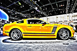 08 February 2012:  2013 Mustang Boss® 302  One-Track Mind.Get serious with the 444-horsepower,* Hi-Po 302 4V Ti-VCT V8 powerhouse..3.73:1 limited-slip rear axle.Brembo front calipers and rotors.Four-gauge instrument cluster.Unique quad exhaust.Adjustable suspension.Optional Laguna Seca Package..Chicago Auto Show, Chicago Automobile Trade Association (CATA), McCormick Place, Chicago Illinois This image was produced in part utilizing High Dynamic Range (HDR) or panoramic stitching or other computer software manipulation processes. It should not be used editorially without being listed as an illustration or with a disclaimer. It may or may not be an accurate representation of the scene as originally photographed and the finished image is the creation of the photographer.