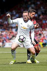 Wayne Rooney of Manchester United is challenged by Andrew Surman of Bournemouth - Rogan Thomson/JMP - 14/08/2016 - FOOTBALL - Vitality Stadium - Bournemouth, England - Bournemouth v Manchester United - Premier League Opening Weekend.