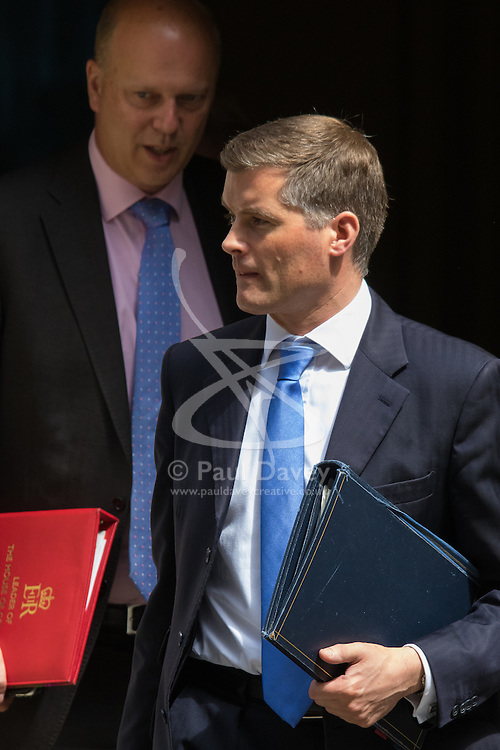 Downing Street, London, June 16th 2015. Leader of the House of Commons Chris Grayling (L) and Chief Whip Mark Harper leave 10 Downing Street following the weekly cabinet meeting.