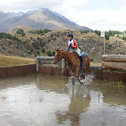 Pamela Thompson riding Oregan Blaze in action at the water jump during the Cross Country event at the Wakatipu One Day Horse Trials at the Pony Club grounds,  Queenstown, Otago, New Zealand. 15th January 2012. Photo Tim Clayton
