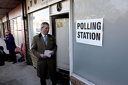 © London News Pictures. 07/05/2015. Leader of the UK Independence Party (UKIP) Nigel Farage arrives at the Echo Shop polling station on Plains of Waterloo road, Ramsgate, Kent, UK to register his vote in the constituency where he hopes to become an MP in the 2015 election. Photo credit: Mary Turner/LNP