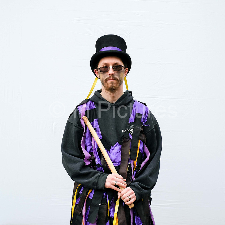Portrait of a Rackaback Morris dancer wearing traditional costume at an orchard-visiting wassail at Sledmere House in the Yorkshire Wolds, United Kingdom on 20th January 2018. Wassail is a traditional Pagan winter celebration in cider-producing regions of England, reciting incantations and singing to the trees to promote a good harvest for the coming year. Pieces of toast soaked in cider are hung in the branches to attract robins to the tree as these are said to be the good spirits of the orchard. To ward off evil spirits, villagers scare them away by banging pots and pans and making as much noise as possible
