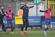 AFC Wimbledon striker Joe Pigott (39), AFC Wimbledon defender George Francomb (7), AFC Wimbledon defender Jon Meades (3) and AFC Wimbledon striker Lyle Taylor (33) warming up during the EFL Sky Bet League 1 match between AFC Wimbledon and Blackpool at the Cherry Red Records Stadium, Kingston, England on 20 January 2018. Photo by Matthew Redman.