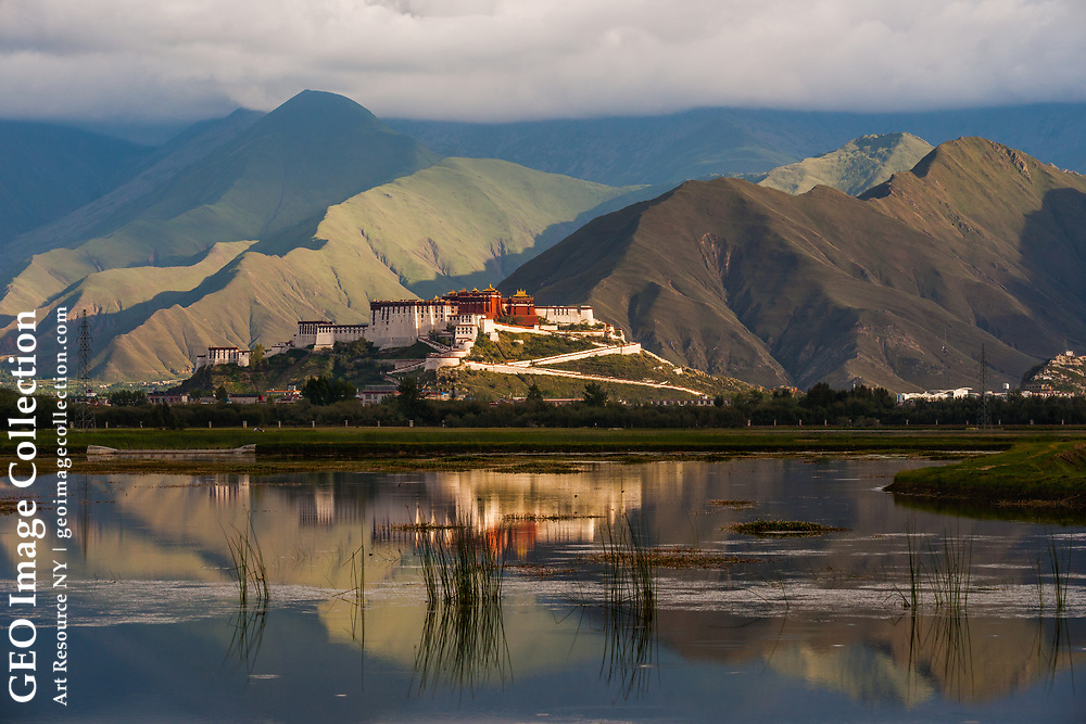 Lhasa's Potala Palace, the monastery that was home to the Dali Lama, is among the most iconic images of Tibet. The Palace seems to float among the mountains, hovering above the marsh in the foreground.
