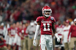 Parnell Motley #11 of the Oklahoma Sooners reacts to a play during the first half against the LSU Tigers in the 2019 College Football Playoff Semifinal at the Chick-fil-A Peach Bowl on Saturday, Dec. 28, in Atlanta. (Paul Abell via Abell Images for the Chick-fil-A Peach Bowl)