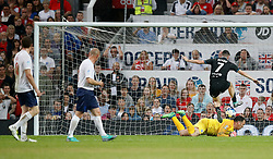 World XI's Robbie Keane (right) scores his side's first goal of the game during the UNICEF Soccer Aid match at Old Trafford, Manchester.