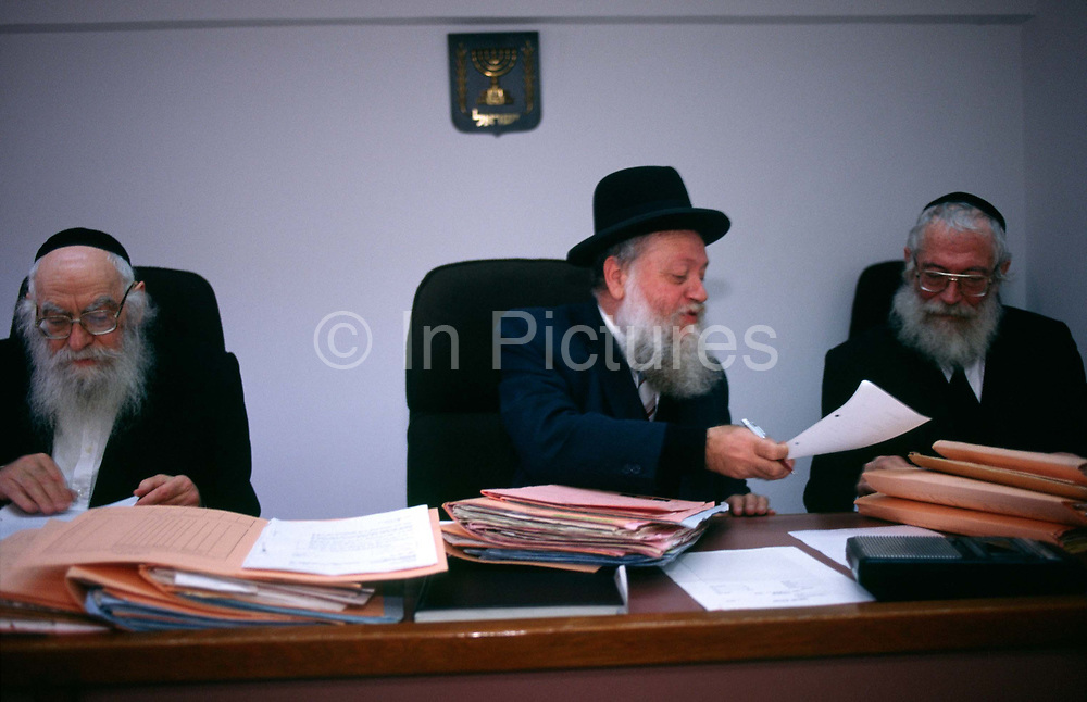 A Rabbinical Court sits in Jerusalem deliberating over a divorce case