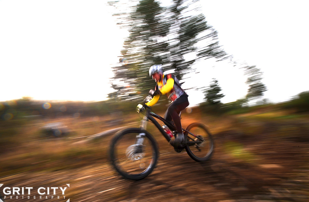 Robert Bradley flies around a corner during the 30K event of the fourth annual Extreme Mountain Bike Race March 27.