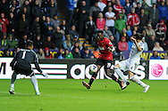 Danny Welbeck of Man Utd shoots and scores his sides 4th goal. Barclays Premier league, Swansea city v Manchester Utd in Swansea, South Wales on Saturday 17th August 2013. pic by Andrew Orchard ,Andrew Orchard sports photography,