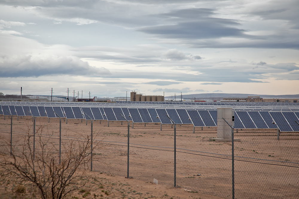 Oil and gas industry site in the Permian Basin next to a solar farm just outside of Carslbad New Mexico