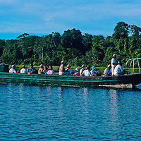 South America, Peru, Amazon River. Tour group on Amazon excursion
