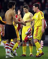 Photo: Paul Thomas.<br />PSV Eindhoven v Liverpool. UEFA Champions League, Quarter Final, 1st Leg. 03/04/2007.<br /><br />Steven Gerrard (Centre) of Liverpool congratulates his team-mates after their win.