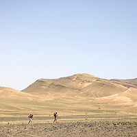 25 March 2007:  Participants run across a blooming desert because of a rainy winter between Irhs and Khermou during the first stage of  the 22nd Marathon des Sables, a 6 days and 151 miles endurance race with food self sufficiency across the Sahara Desert in Morocco. Each participant must carry his, or her, own backpack containing food, sleeping gear and other material.