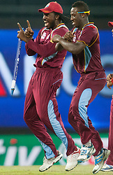 © Licensed to London News Pictures. 05/10/2012. West Indians Chris Gayle & Andre Russell dance Gangnam Style during the World T20 Cricket Mens Semi Final match between Australia Vs West Indies at the R Premadasa International Cricket Stadium, Colombo. Photo credit : Asanka Brendon Ratnayake/LNP