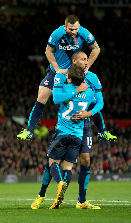 Steven N'Zonzi of Stoke City is congratulated by team-mates Bojan Krkic (foreground) and Phillip Bardsley (jumping) after scoring the equalising goal to make it 1-1 during the Barclays Premier League match at Old Trafford, Manchester<br /> Picture by Russell Hart/Focus Images Ltd 07791 688 420<br /> 02/12/2014