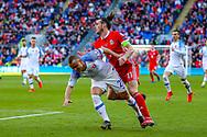 Wales midfielder Gareth Bale is blocked by Slovakia midfielder Stanislav Lobotka  during the UEFA European 2020 Qualifier match between Wales and Slovakia at the Cardiff City Stadium, Cardiff, Wales on 24 March 2019.
