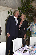 Mr. and Mrs. Galen Weston, Cartier Flower show dinner, Chelsea Physic garden, 24 May 2004. ONE TIME USE ONLY - DO NOT ARCHIVE  © Copyright Photograph by Dafydd Jones 66 Stockwell Park Rd. London SW9 0DA Tel 020 7733 0108 www.dafjones.com